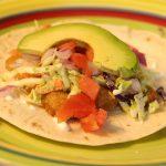 Fish taco with avocado and cilantro slaw