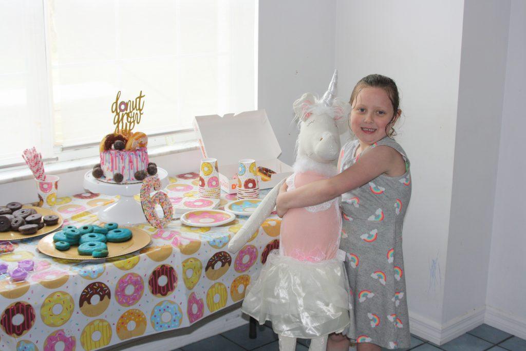 birthday girl at her donut birthday party