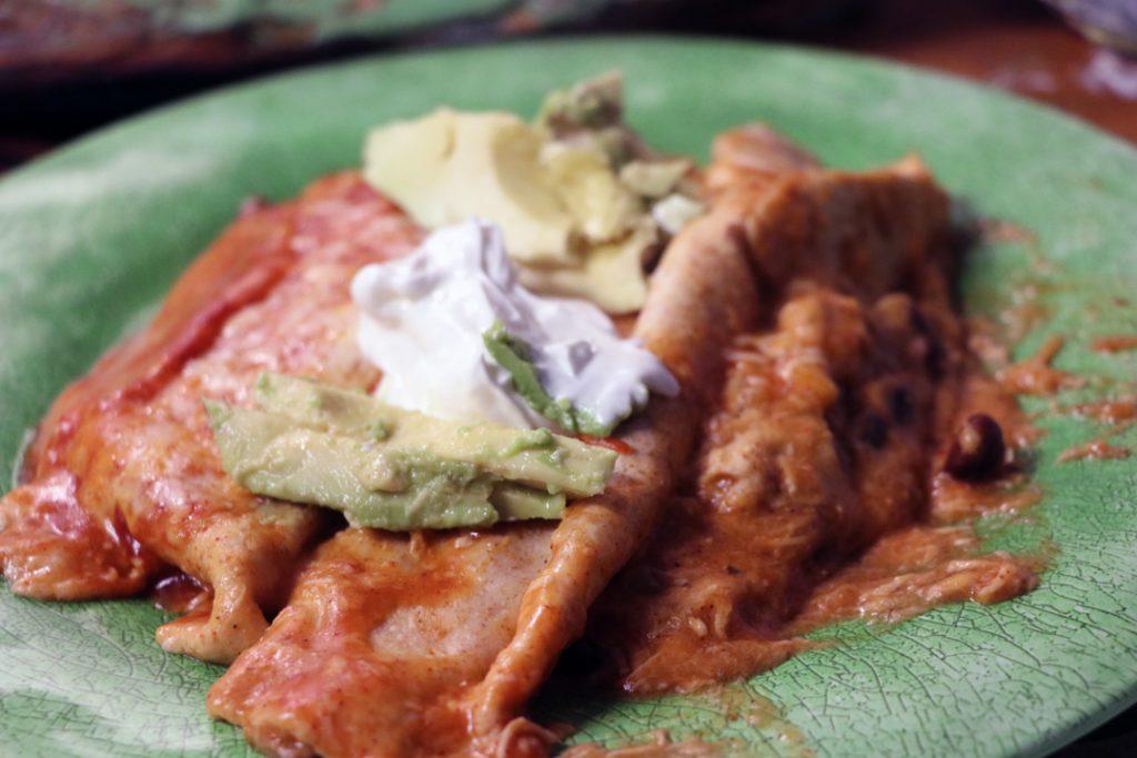 chicken enchilada with sour cream and avocado